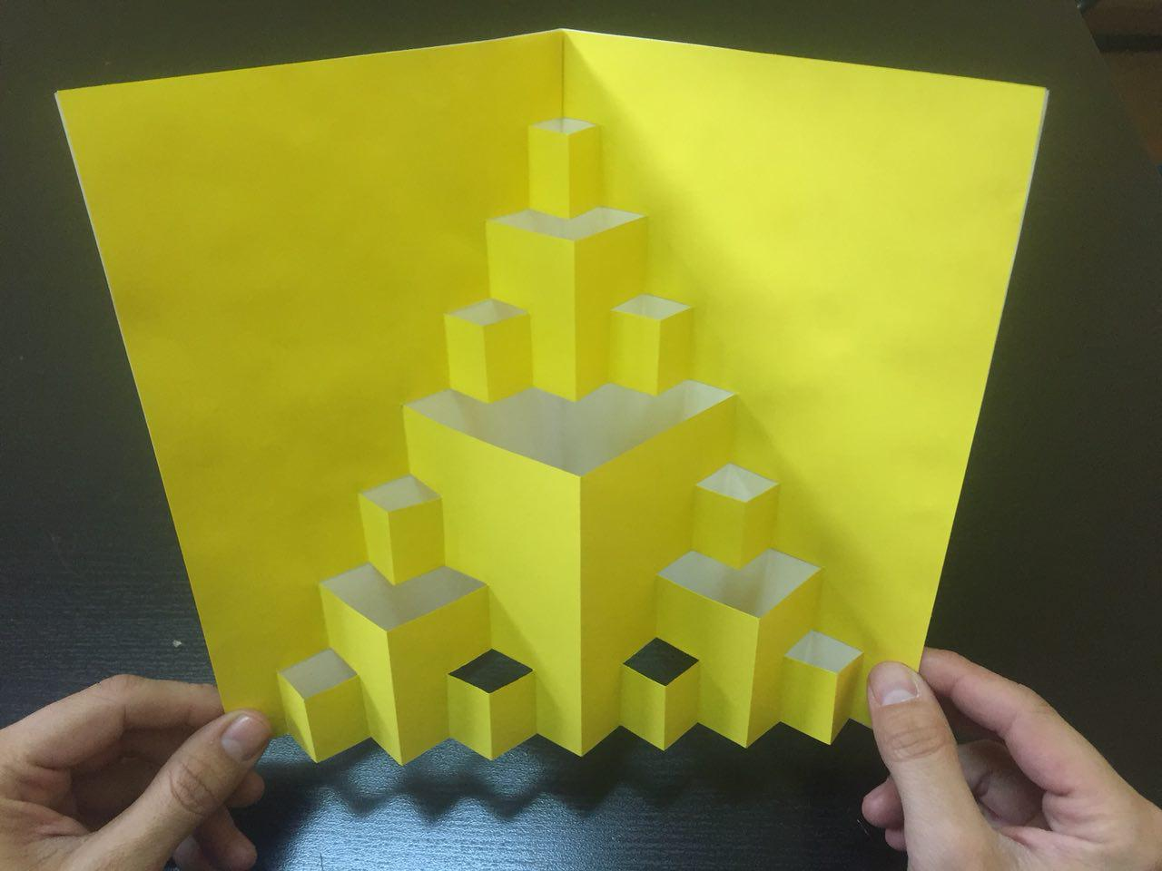 Un triángulo de Sierpinski con papel